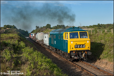 D7076 thrashes through Kelling Heath cutting with a short mixed freight on 11/06/2015.