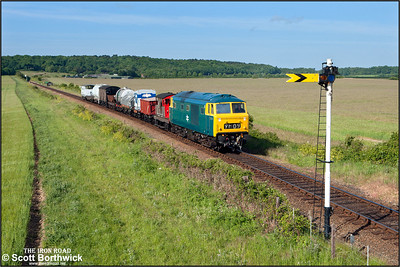 D7076 approaches Weybourne's distant signal as it accelerates away from Weybourne with a short mixed freight on 11/06/2015. (Photo taken with camera mounted on a pole & remotely triggered)