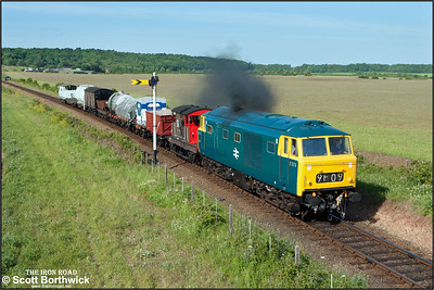 D7076 passes Weybourne's distant signal as it accelerates away from Weybourne with a short mixed freight on 11/06/2015. (Photo taken with camera mounted on a pole & remotely triggered)
