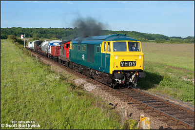 At a little before 0730 on 11/06/2015, D7076 catches the early morning light thrashing away from Weybourne with a short mixed freight. (Photo taken with camera mounted on a pole & remotely triggered)