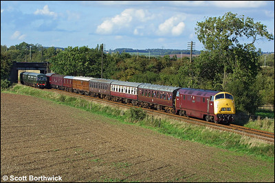 D832 'Onslaught' passes a Class 101 DMU at Woodthorpe whilst working 2A39 1630 Loughborough-Leicester North on 18/09/2004.