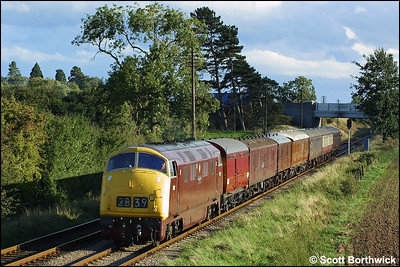 There is just a hint of autumn as D832 cathes the setting suns rays at Woodthorpe whilst working 2B39 1710 Leicester North-Loughborough on 18/09/2004.