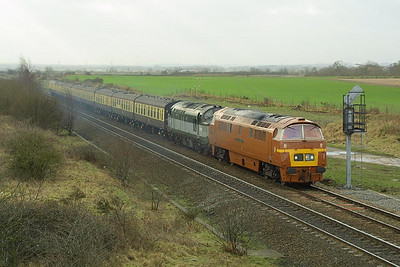 D1015 'Western Champion' is pictured at Catholme on its mainline proving run, 1Z15 1010 Kidderminster-Walsall (via Sheffield), with 37197 tucked inside for insurance on 28/01/2002.