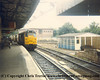 Class 31 Diesel Locomotive number 31 124 passes Exeter St Davids with a train load of Tiger PBA china clay wagons.<br /> 4th August 1986