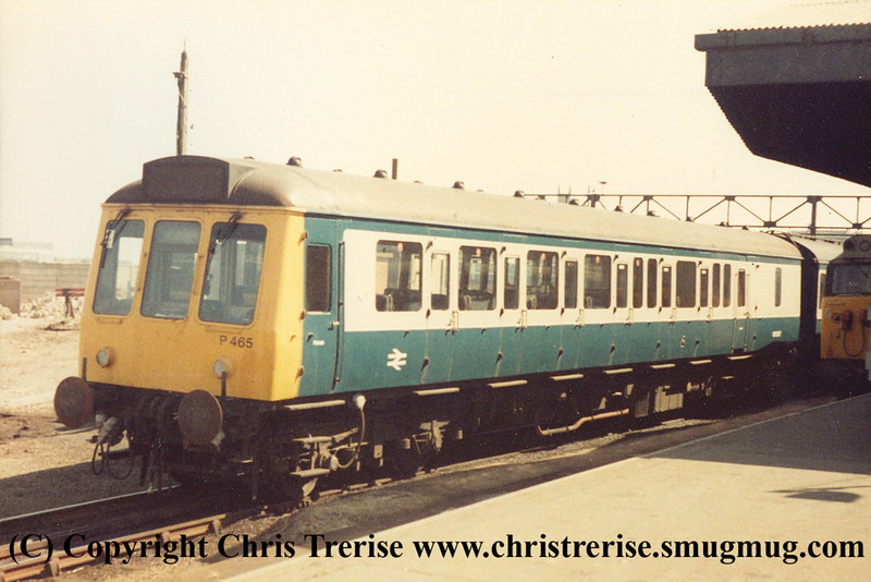 "Class 118 3 Car DMU number P465 at Penzance.  The unit at this time was working as a hybrid with part of P466 in the formation.  Class 50 Diesel Locomotive number 50 030 named ""Repulse"" can be just glimpsed alongside.<br /> 2nd June 1985"