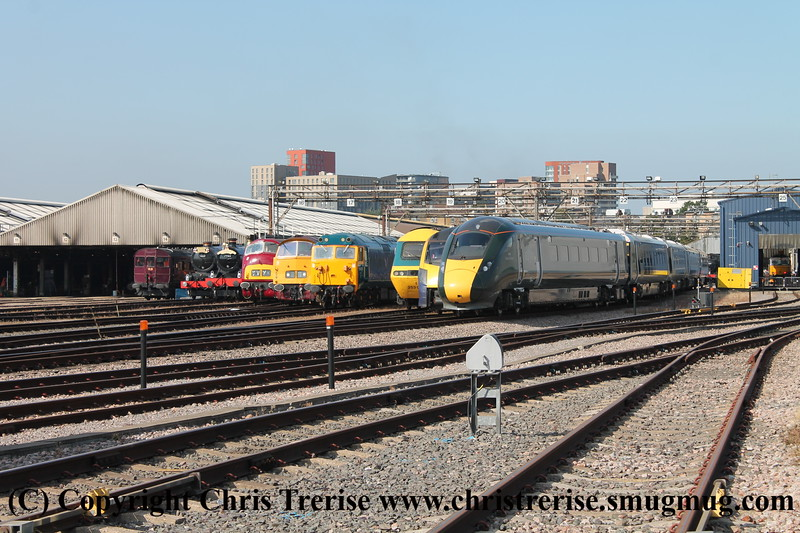 "Old Oak Common line up - left to right, Steam Railmotor number 93, King number 6023 ""King Edward II"", Hall number 7903 ""Formarke Hall"", Warship Class 42 number D821 ""Greyhound"", Western Class 52 number D1015 named ""Western Champion"", Class 50 number 50 035 ""Ark Royal"", Class 43 number 43 002 ""Sir Kenneth Grange"", Class 180 number 180 102 and Class 800/0 number 800 003 ""Queen Elizabeth / Queen Victoria"".<br /> 2nd September 2017"