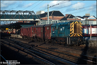 08492 trundles through Doncaster with a trip working comprising of two ferryvans on 24/12/1990.