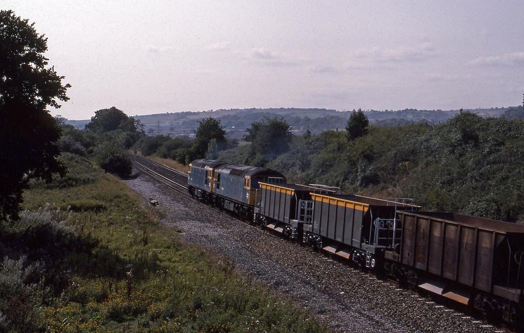 33208/33002, down ballast empties, Whiteball, 23-8-89.