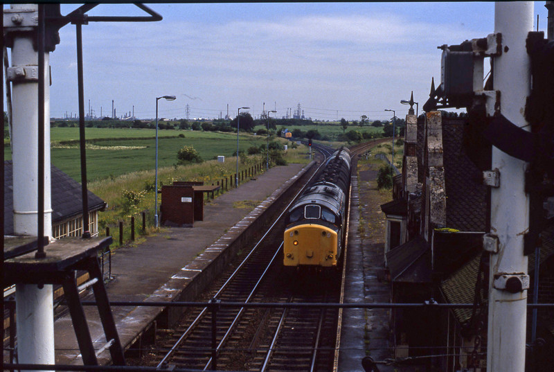 37719, westbound tanks, 37886, eastbound light, Brocklesby, 23-6-94.