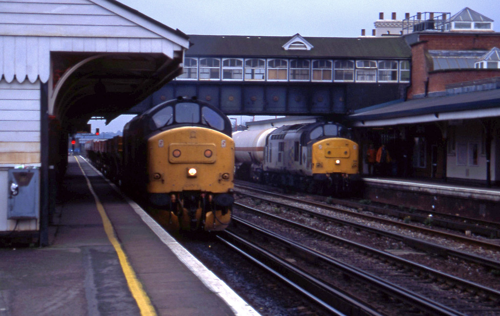 37264, up ballast to Chandler's Ford branch, Eastleigh, 8-11-94. 37891, up tanks.