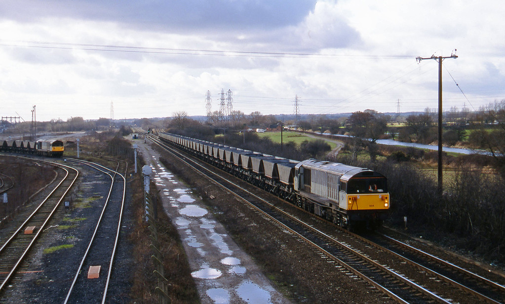 58004, down mgr empties; 58035, departing Willington Power Station, Stenson Junction, near Derby, 17-2-95.