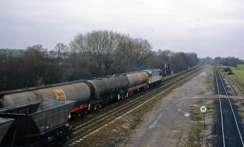 56087, down tanks, Stenson Junction, near Derby, 24-2-95.