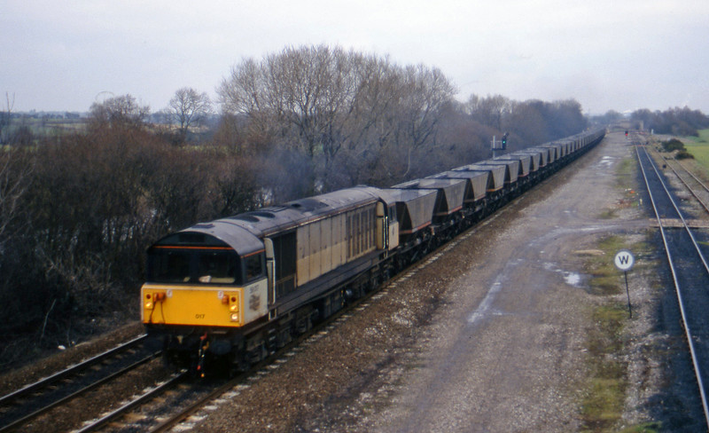 58017, up mgr empties. Stenson Junction, near Derby, 24-2-95.