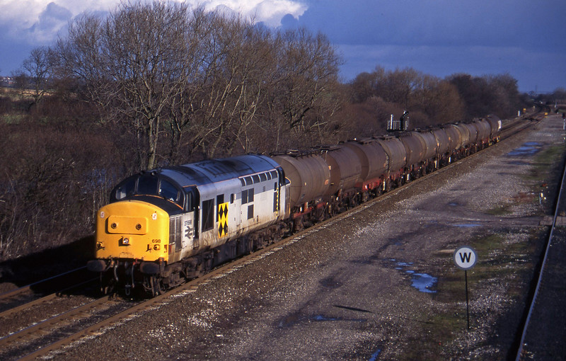37698, up tanks, Stenson Junction, near Derby, 17-2-95.