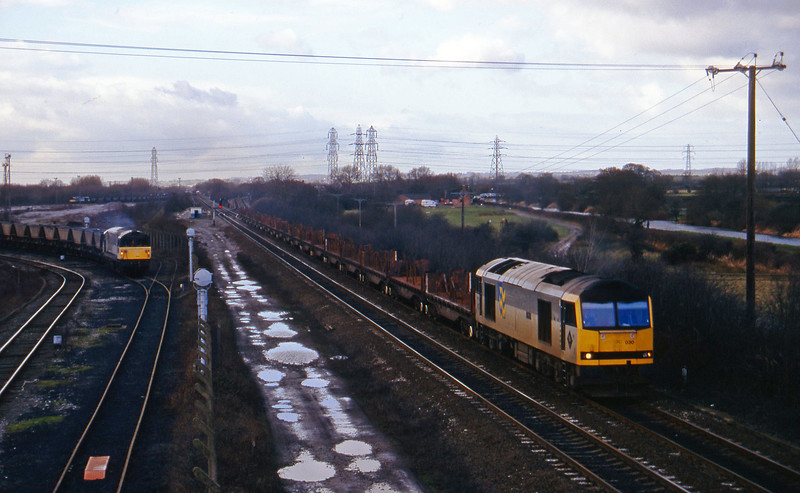 60030, down steel; 58014, Willington Power Station-Toton Yard mgr empties, Stenson Junction, near Derby, 17-2-95.