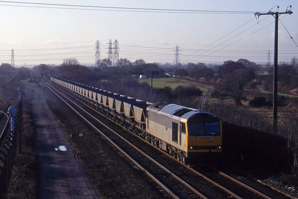 60094, mgr empties, south to Sheet Stores line, Stenson Junction, near Derby, 6-1-95.
