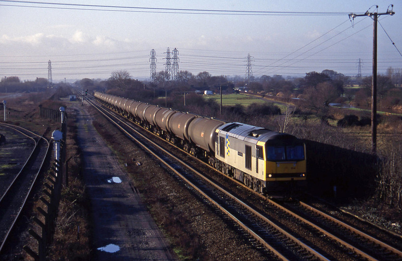 60014, tanks from south to Sheet Stores line, Stenson Junction, near Derby, 6-1-95.