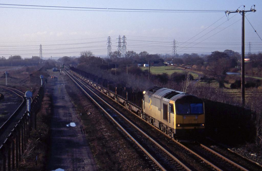 60022, Etruria-Lackenby steel empties, Stenson Junction, near Derby, 6-1-95.