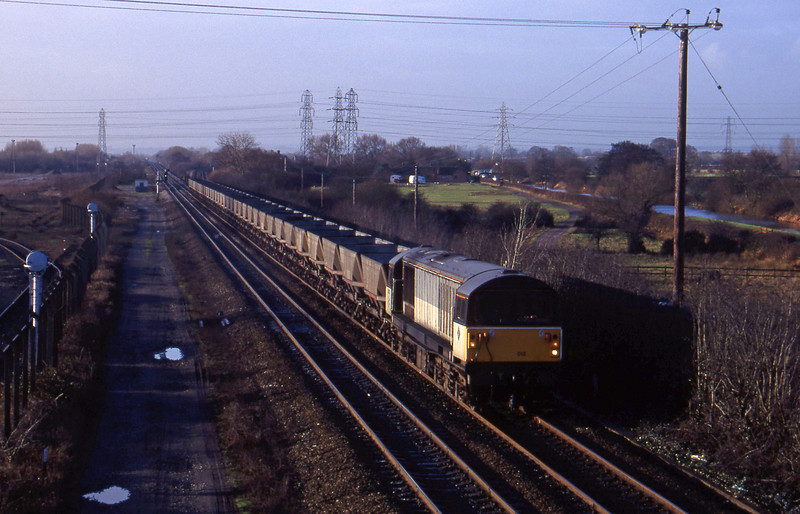 58012, coal empties from south to Sheet Stores line, Stenson Junction, near Derby, 6-1-95.