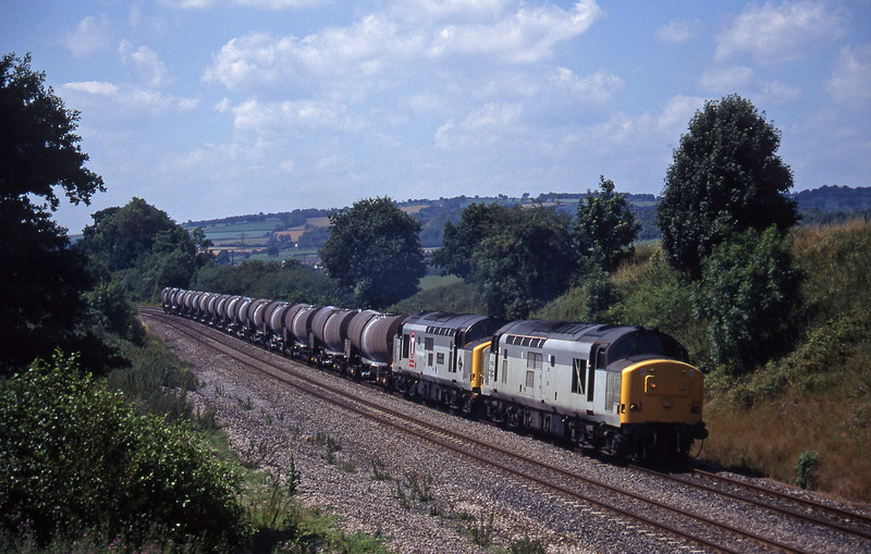 37674/37413, last weekday 37-hauled 09.40 Burngullow-Irvine, Whiteball, 20-7-95.
