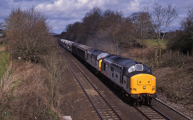 37670/37673, 08.50 Bescot-St Blazey,  Willand, near Tiverton, 25-3-95.
