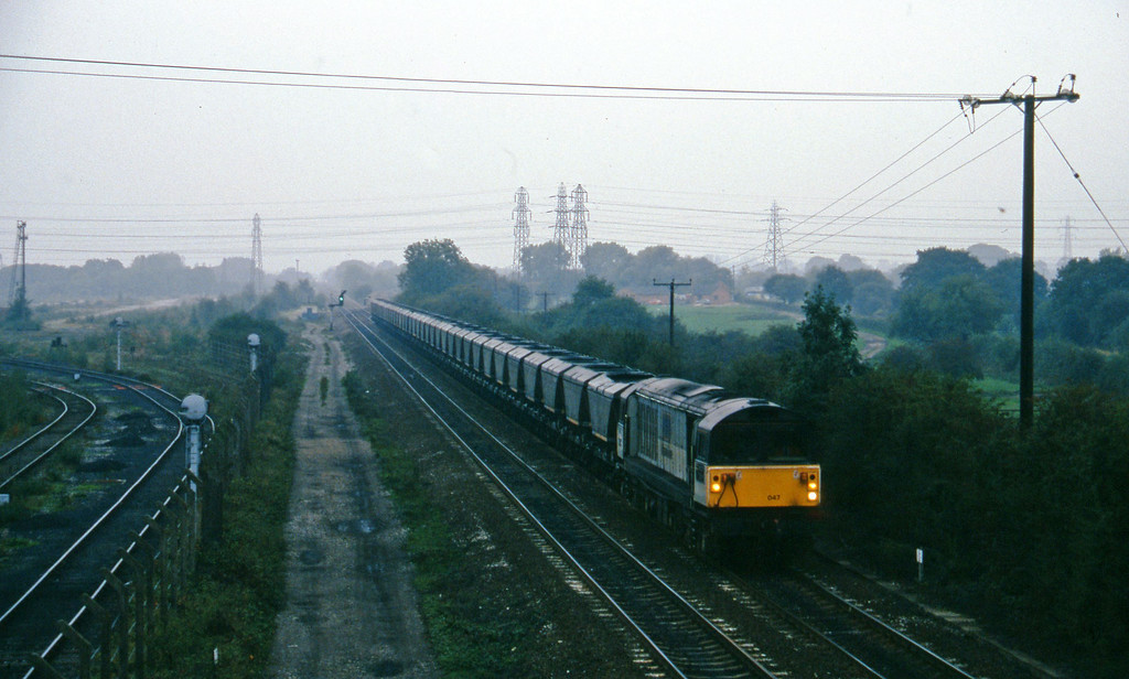 58047, south to east mgr empties, Stenson Junction, near Derby, 11-10-95.