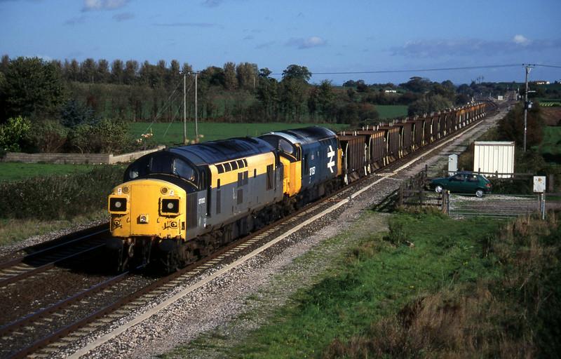 37012/37057,down ballast empties, Cogload, 25-10-95.