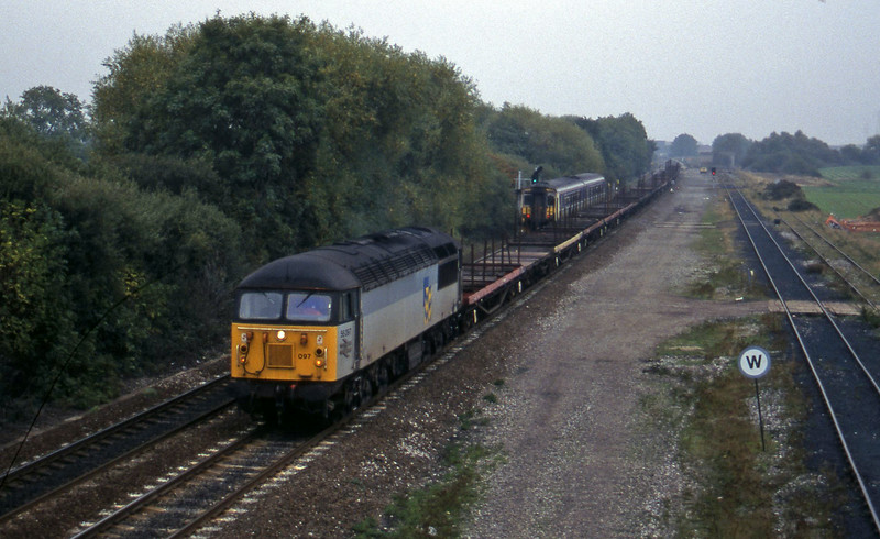 56097, north to south steel empties, Stenson Junction, near Derby, 11-10-95.