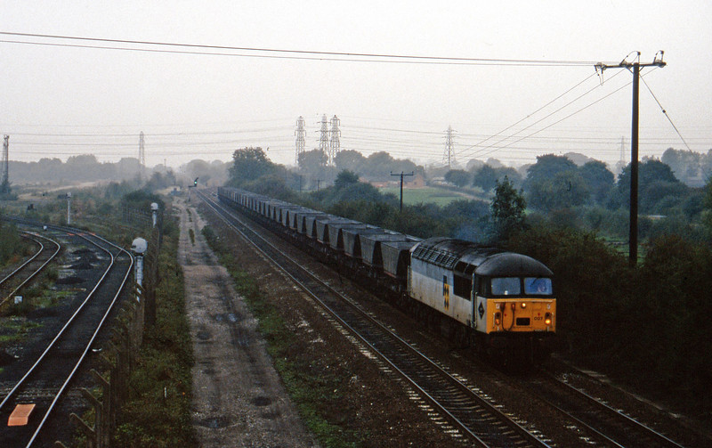 56007, down mgr empties to Toton Yard, Stenson Junction, near Derby, 11-10-95.