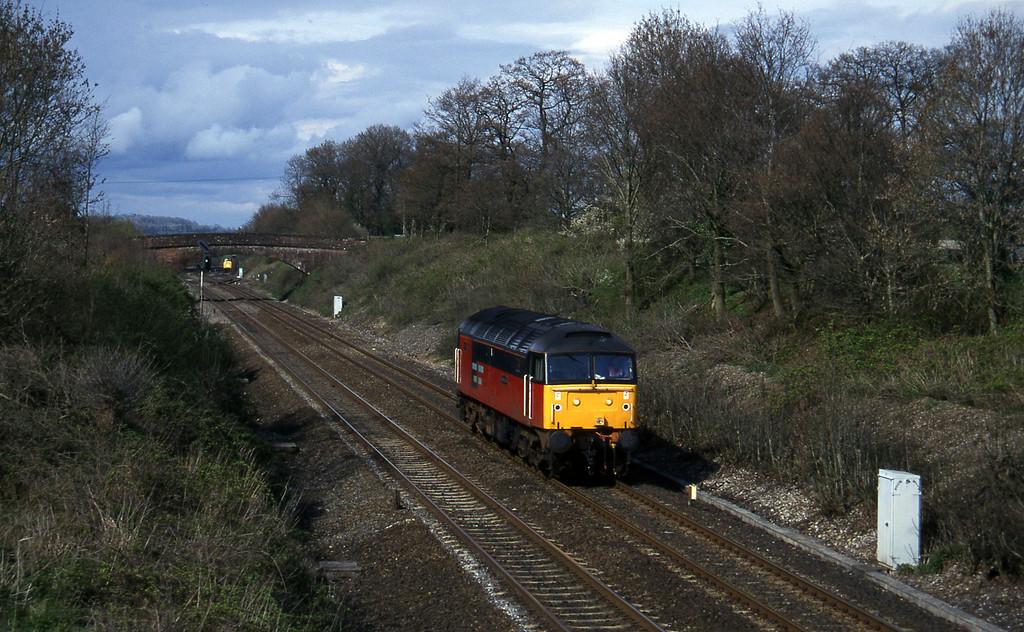 47737, down light, Willand, near Tiverton, 30-4-96, passing 37670, down departmental, in Tiverton Loop.