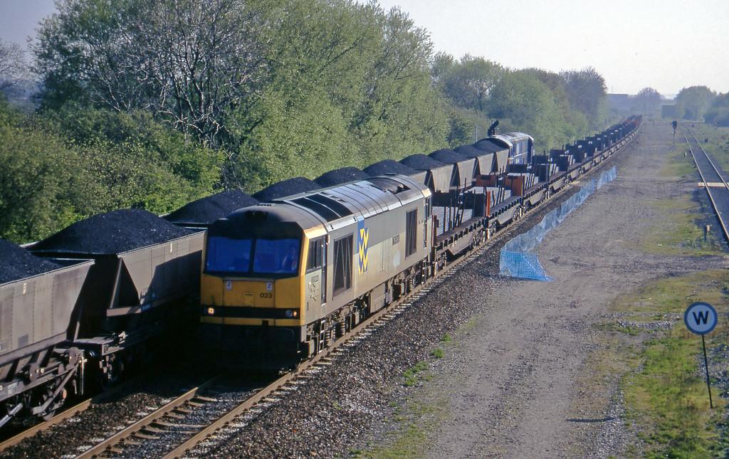60023, up steel slabs, Stenson Junction, near Derby, 14-5-96.