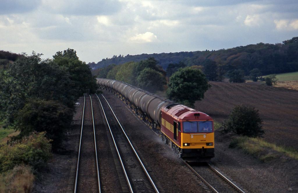 60026, Kingsbury Oil Terminal-Immingham empties, Melton Ross, near Barnetby, 1-10-96.