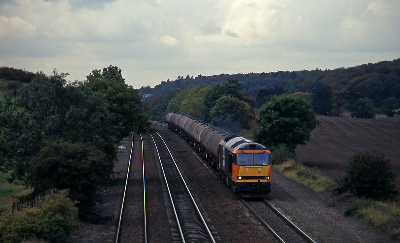 60025, Welton-Immingham empties, Melton Ross, near Barnetby, 1-10-96.