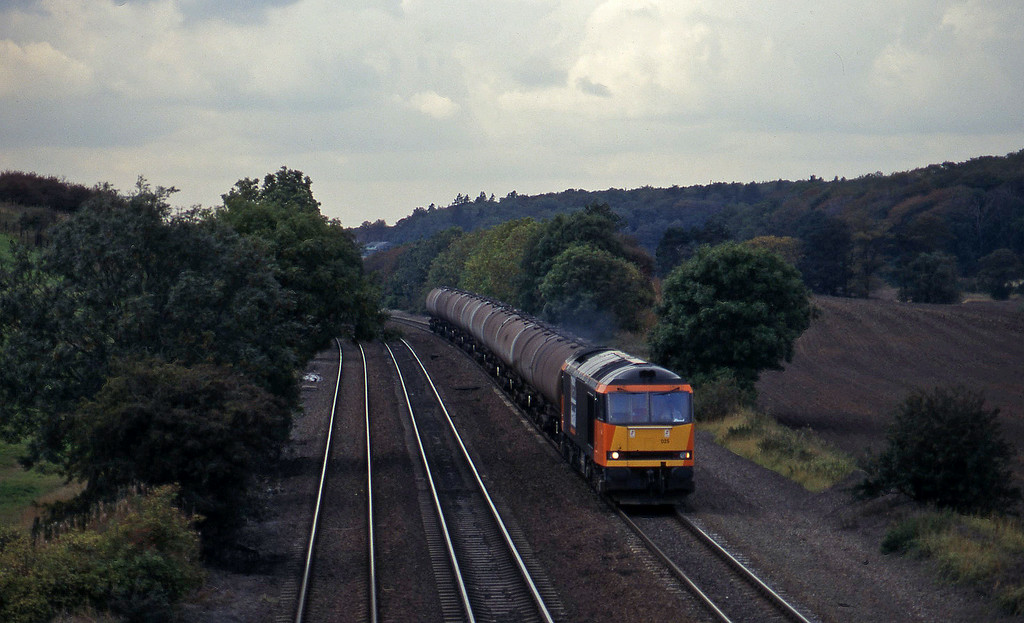 60025, Welton-Immingham empties, Melton Ross, near Barnetby, 1-10-96.
