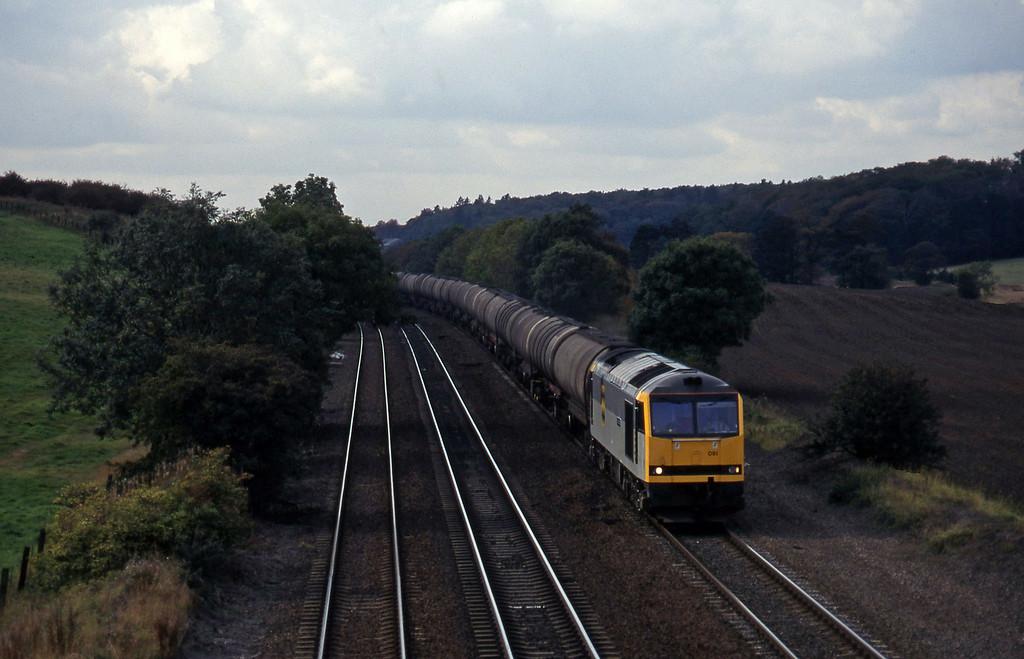 60091, Nottingham Rectory Junction-Immingham empties, Melton Ross, near Barnetby, 1-10-96.