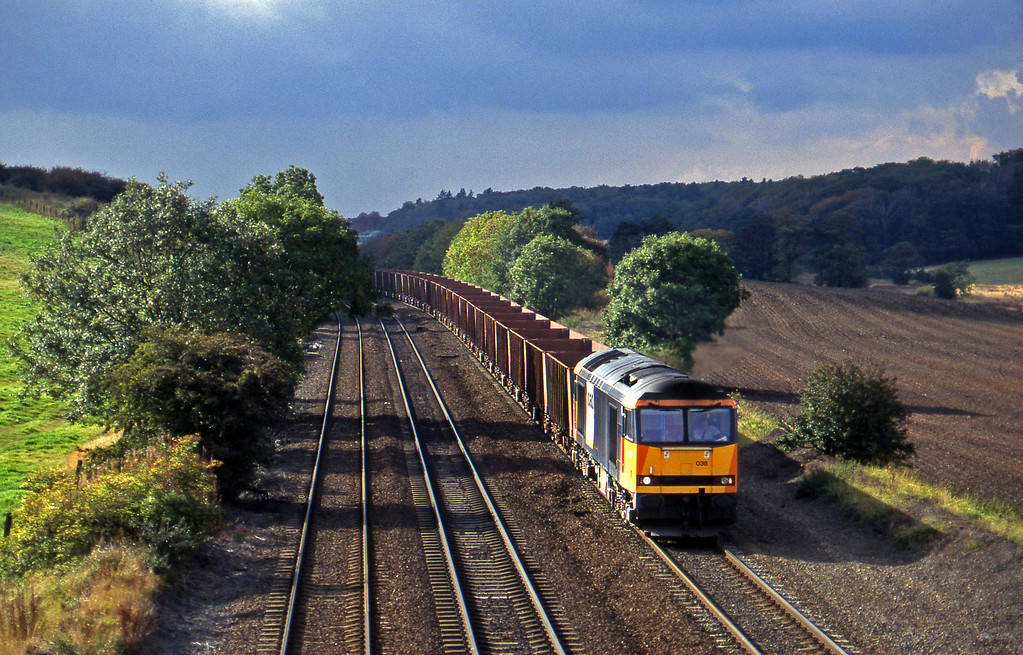 60038, eastbound ore empties, Melton Ross, near Barnetby, 1-10-96.