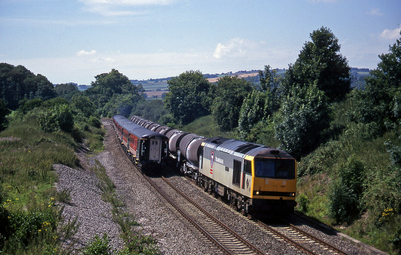 60081, 09.40 Burngullow-Newport Alexandra Dock Junction,Whiteball, 29-7-97, passing 47843, 09.10 Liverpool Lime Street-Plymouth, hauling new stock.