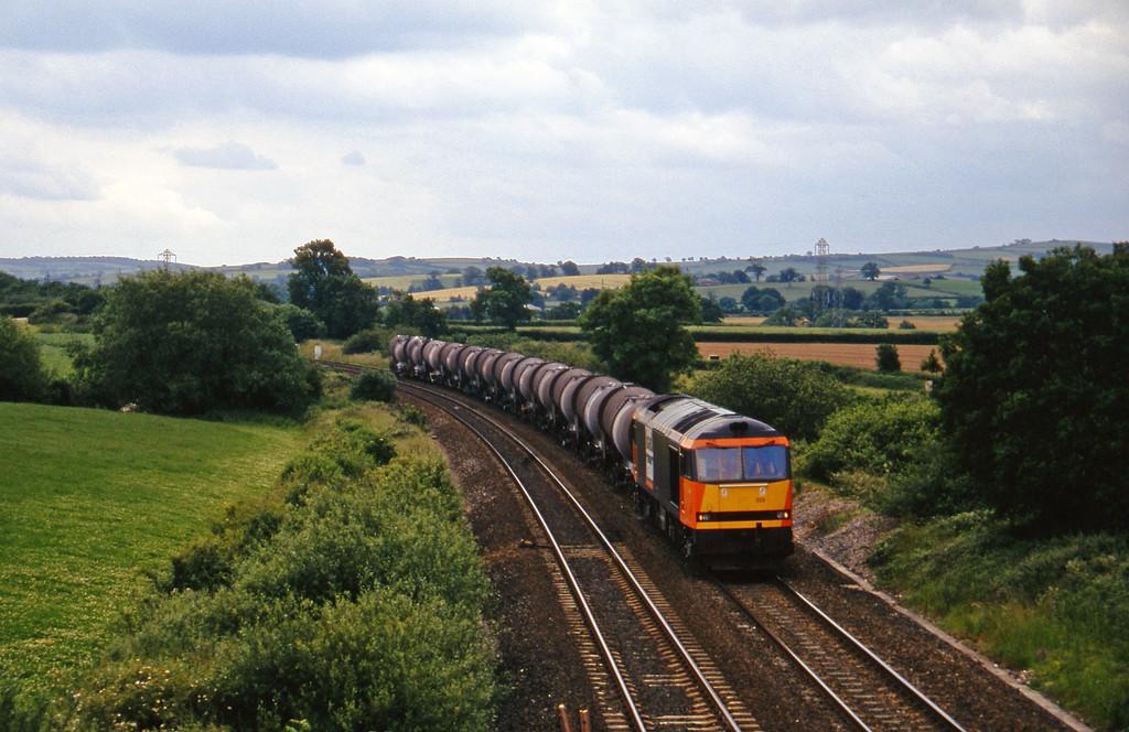 60025, 09.40 Burngullow-Newport Alexandra Dock Junction Yard, Willand, near Tiverton, 24-6-97.