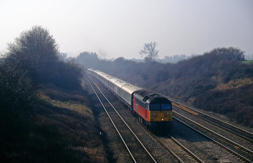 47765, 09.03 London Paddington-Cheltenham, Standish Junction, near Stroud, 11-3-97. Cheltenham Races special.