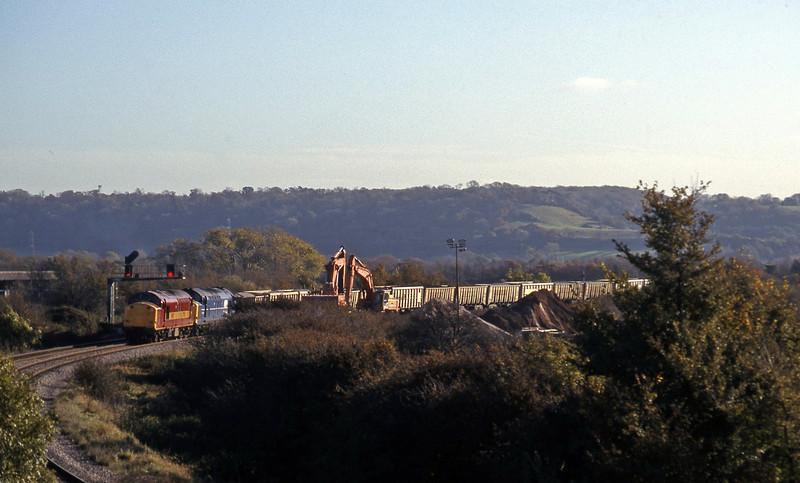 37716/37274, unloading Merehead Quarry-Hallen Marsh, Hallen Marsh, 11-11-97.