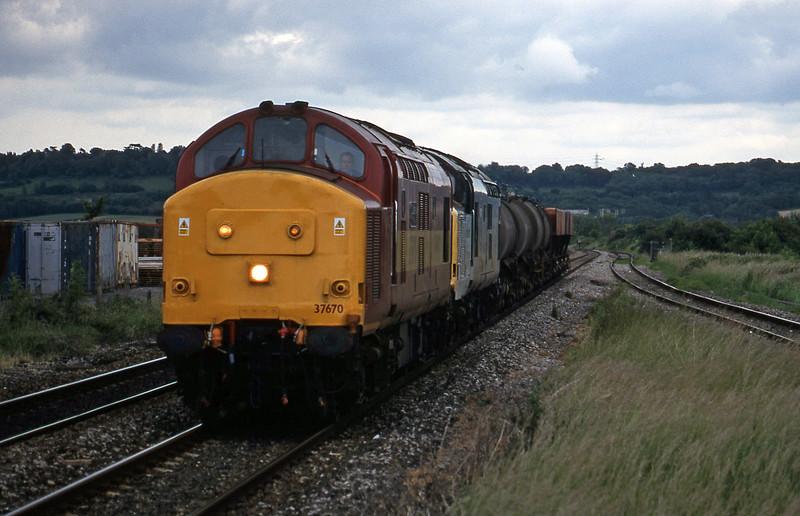 37670/37672, 04.18 St Blazey-Newport Alexandra Dock Junction, Pilning, 11-6-98.