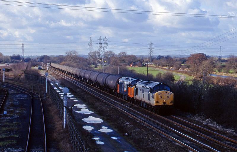 37131/37710, tanks south-east, Stenson Junction, near Derby, 4-3-98.