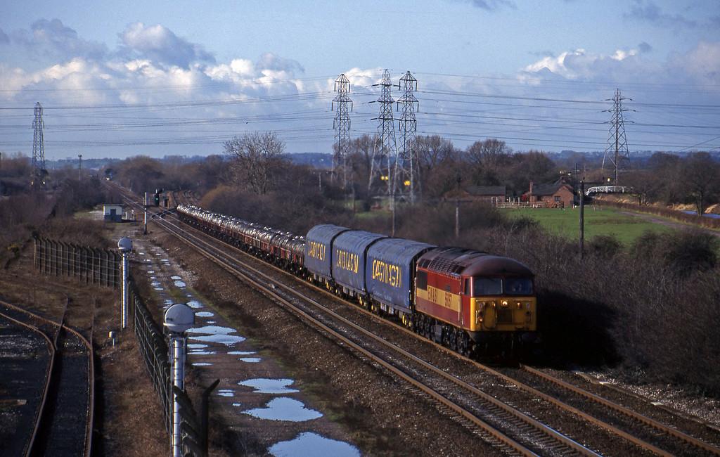 56057, steel south-north, Stenson Junction, near Derby, 4-3-98.