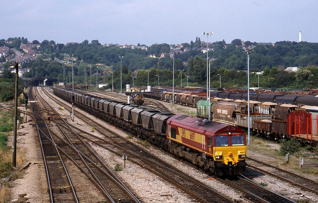 66097, 14.25 Llanwern-Grange Sidings, Newport Alexandra Dock Junction, 12-8-99.