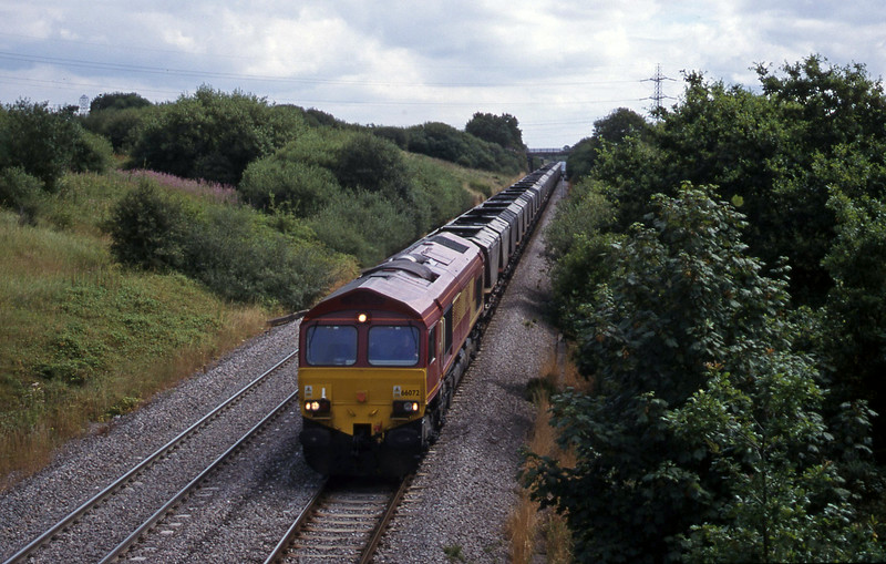 66072, Llanwern-Grange Sidings mgr empties, Stormy Down, near Bridgend, 3-8-99.