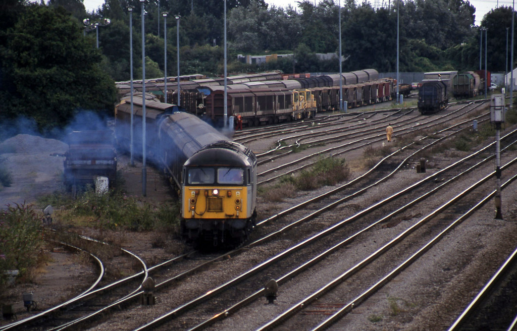 56072, 13.57 Cardiff Canton-Mossend, departing Newport Alexandra Dock Junction, 13-8-99.