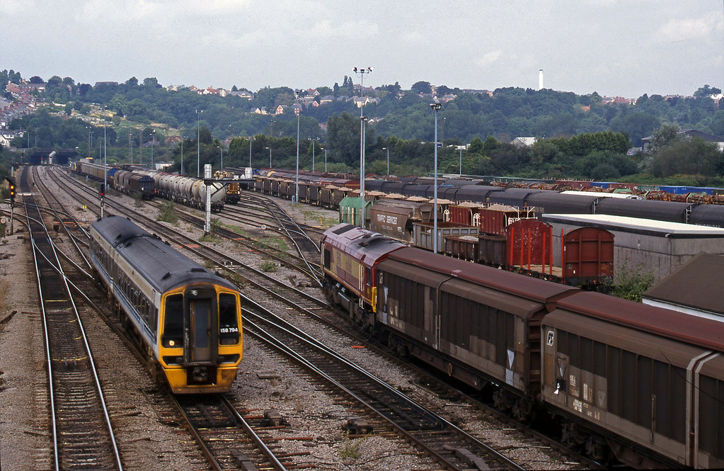 66068, 13.57 Cardiff Canton-Mossend, Newport Alexandra Dock Junction, 12-8-99. 158794, down.