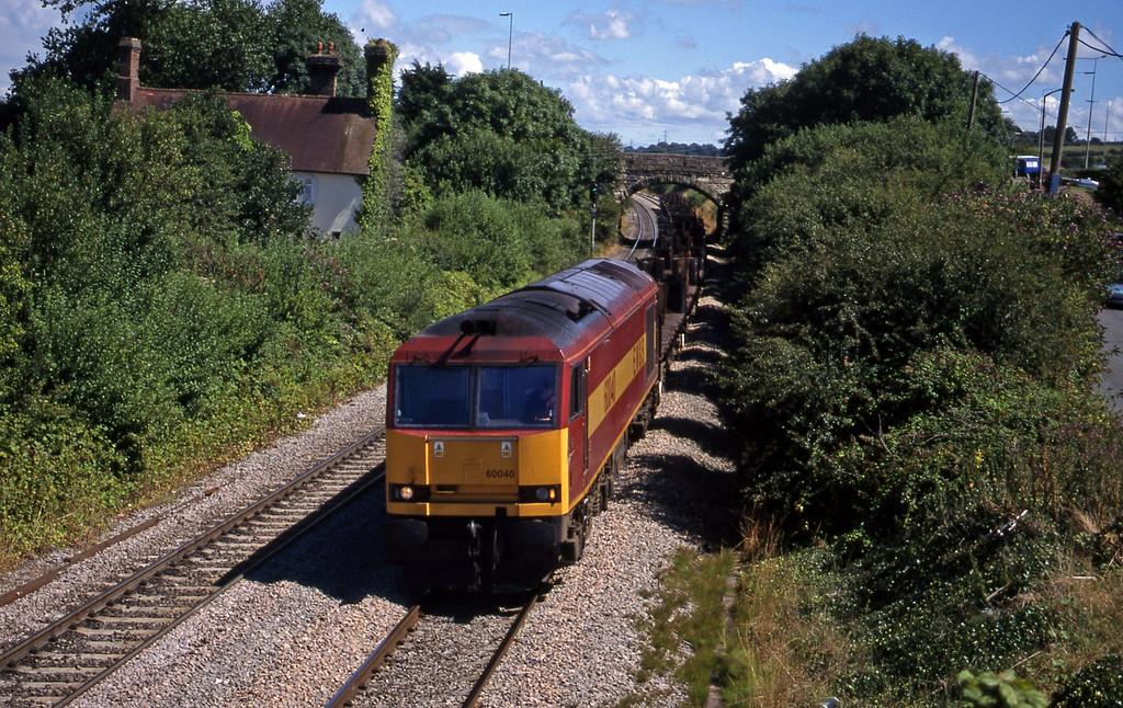 60040, down steel empties, Pyle, near Bridgend, 3-8-99.