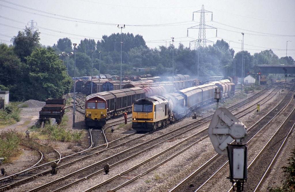 66068, shunting, 13.57 Cardiff Canton Mossend, 60080, 14.17 Newport Alexandra Dock Junction-St Blazey, departing, Newport Alexandra Dock Junction, 12-8-99.