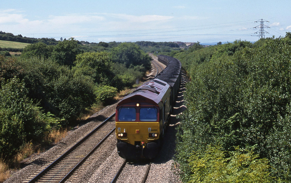 66088, 12.10 Grange Sidings-Llanwern, Stormy Down, near Bridgend, 3-8-99.